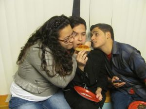 A very popular piece of pizza (Daniela Ortiz, Michael Xayavong, and Kevin Padilla, all North High School students.)